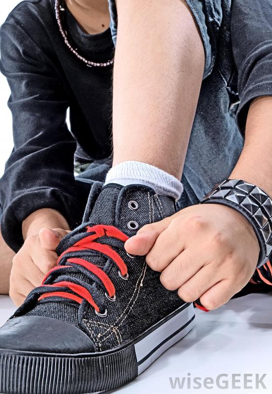 boy-tying-shoes-with-red-shoelaces